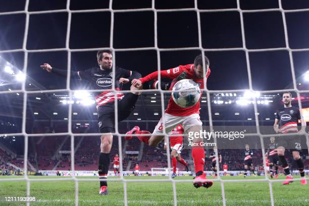 Levin Oztunali of 1.FSV Mainz 05 scores the first goal under pressure from Markus Suttner of Fortuna Dusseldorf during the Bundesliga match between...
