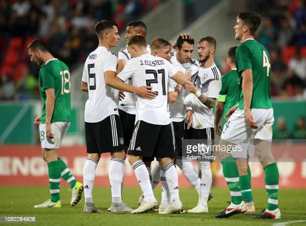 Levin Oztunali of Germany U21 celebrates with teammates after scoring his team's second goal during the 2019 UEFA Under21 European Championship...