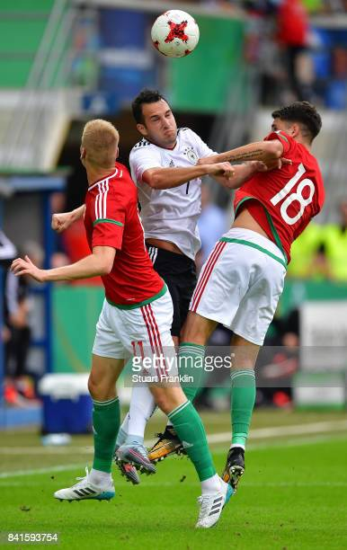 Levin ztunali of Germany U21 is challenged by Csaba Spandler and Dominik Szoboszlai of Hungary 21 during the International friendly match between...
