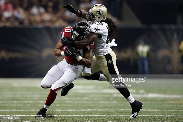 Levine Toilolo of the Atlanta Falcons is brought down by Dannell Ellerbe of the New Orleans Saints during the second quarter of a game at the...