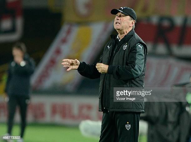 Levir Culpi coach of Atletico Mineiro gestures during a match between Independiente Santa Fe and Atletico Mineiro as part of Copa Bridgestone...