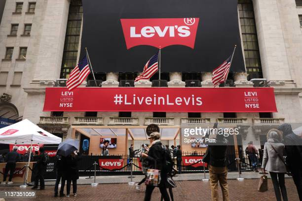 Levi's banner hangs from the New York Stock Exchange on the day that Levi Strauss has returned to the stock market with an IPO on March 21 2019 in...
