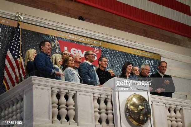 Levi's employees and owners ring the Opening Bell on the floor of the New York Stock Exchange on the day that Levi Strauss has returned to the stock...