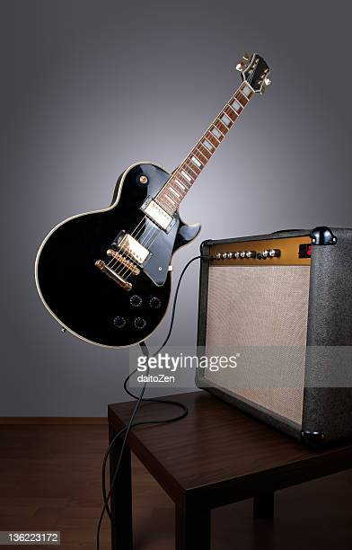 levitating electric guitar - electric guitar stock pictures, royalty-free photos & images