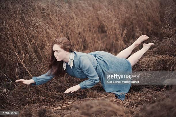 Levitating woman in blue dress
