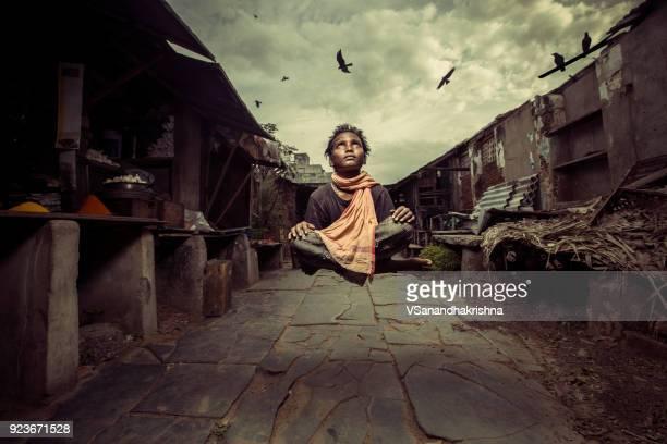 levitation shot of poor boy at slum area poverty concept - slum stock pictures, royalty-free photos & images