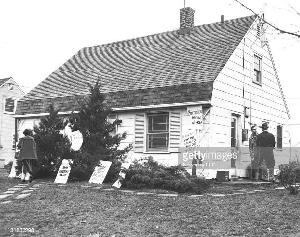 A house sublet by William Cotter and his family was plastered with signs in the front yard in a last effort to prevent the eviction of the family...