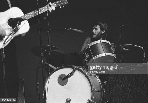 Levon Helm of The Band plays the drums during a concert at Queens College New York