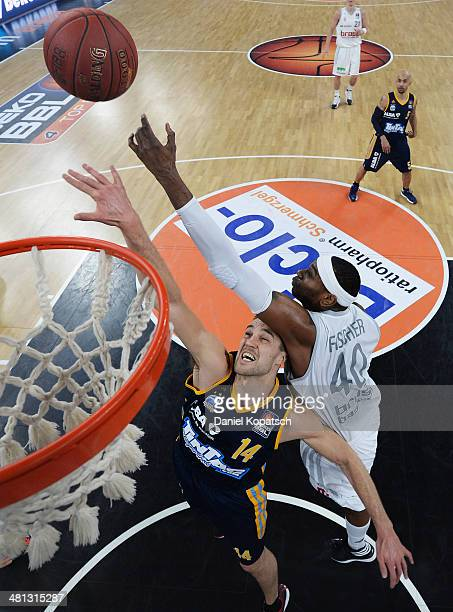 Levon Kendall of Berlin is challenged by D'Or Fischer of Bamberg during the Beko BBL Top Four semifinal match between Alba Berlin and Brose Baskets...