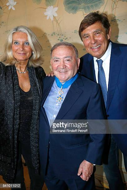 Levon Sayan standing between JeanPierre Foucault and his wife Evelyn Jarre attend Levon Sayan receives Insignia of Commandeur de l'Ordre National du...