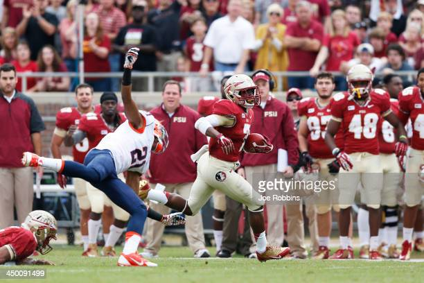 Levonte Whitfield of the Florida State Seminoles runs for a 74-yard touchdown against the Syracuse Orange during the first quarter of the game at...