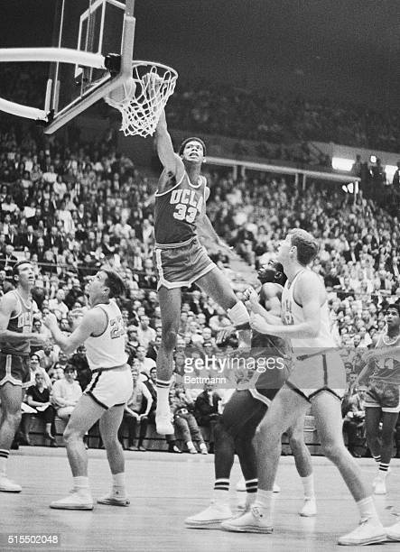 Lew Alcindor #33 of the UCLA Bruins and the future Kareem AbdulJabbar makes two points while sailing over Stan Green and Rich Wright of Georgia Tech...