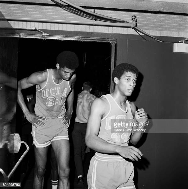 Lew Alcindor Jr and Michael Warren leave the court after a UCLA vs Oregon basketball game Oregon 1966