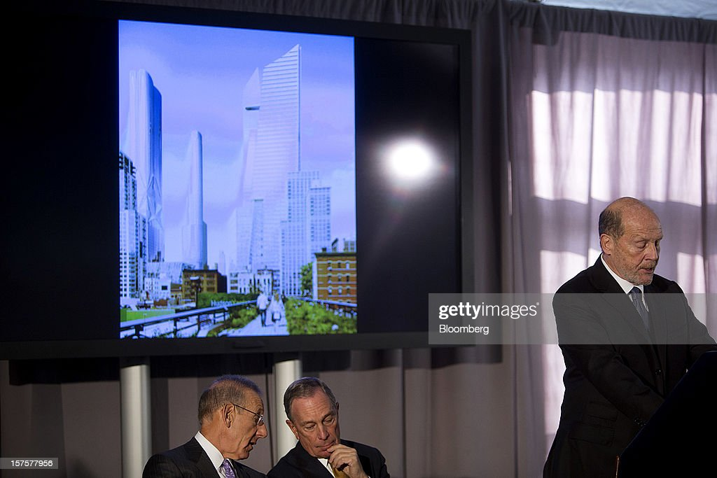Lew Frankfort, chief executive officer of Coach Inc., speaks while Stephen Ross, chairman and founder of Related Cos., left, chats with Michael Bloomberg, mayor of New York City, center, during the groundbreaking ceremony for the Hudson Yards development in New York, U.S., on Tuesday, Dec. 4, 2012. Related Cos. has tentative deals in place for two more tenants to occupy the first tower of its Hudson Yards development, Ross said today as construction began at the 26-acre site on Manhattan's west side. Photographer: Victor J. Blue/Bloomberg via Getty Images