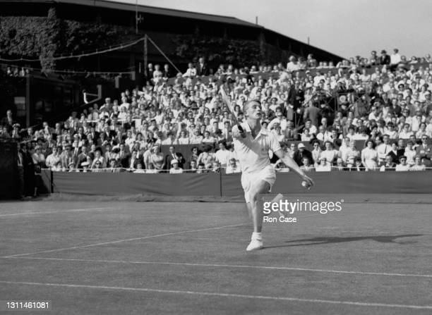 Lew Hoad of Australia reaches to play a forehand return to Don Fontana of Canada during their Men's Singles First Round match at the Wimbledon Lawn...