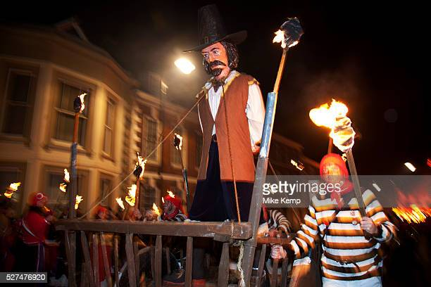 Lewes UK Monday 5th November 2012 Cliffe bonfire society members carry an effigy of Guy Fawkes Bonfire Night celebration in the town of Lewes East...
