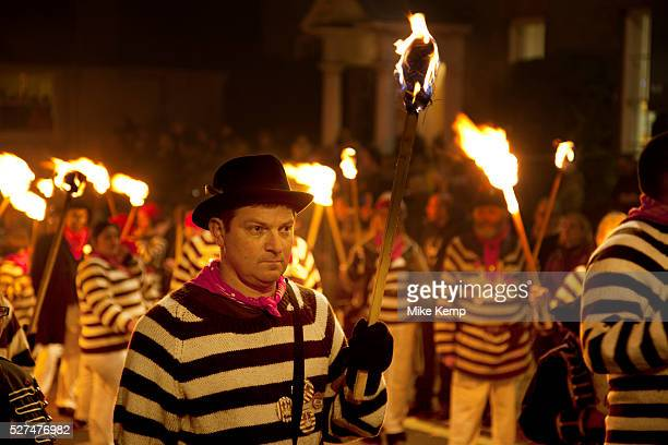 Lewes UK Monday 5th November 2012 Cliffe bonfire society members carry burning torches Bonfire Night celebration in the town of Lewes East Sussex UK...