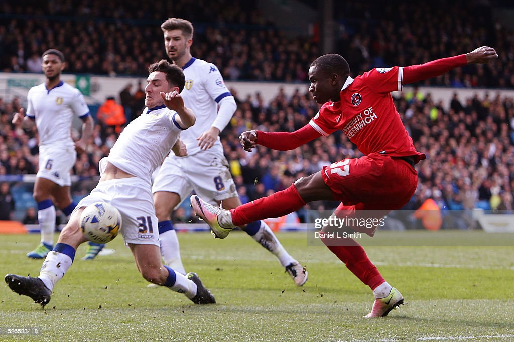 Lewie Coyle of Leeds United FC defelcts a shot at goal from Ademola Lookman of Charlton Athletic FC during the Sky Bet Championship match between Leeds United and Charlton Athletic at Elland Road on April 30, 2016 in Leeds, United Kingdom.