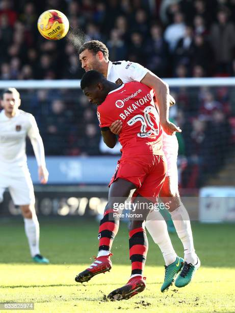 Lewin Nyatanga of Northampton Town contests the ball with Amadou Bakayoko of Wallsall during the Sky Bet League One match between Walsall and...