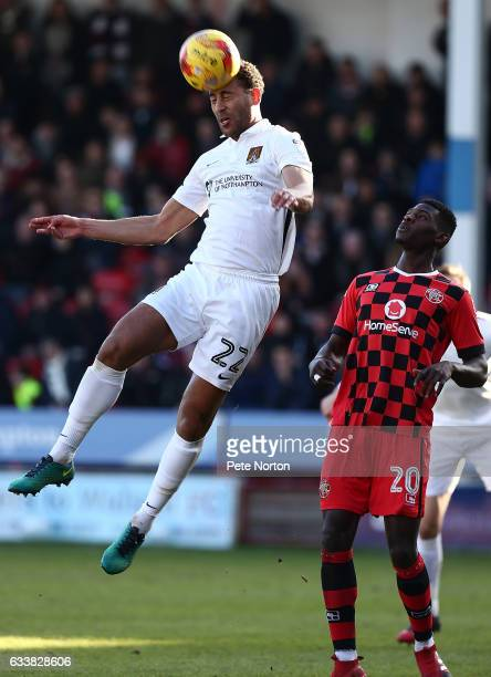 Lewin Nyatanga of Northampton Town heads the ball clear watched by Amadou Bakayoko of Walsall during the Sky Bet League One match between Walsall and...