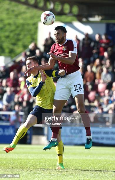 Lewin Nyatanga of Northampton Town rises above Antonio Martinez of Oxford United to head the ball during the Sky Bet League One match between...