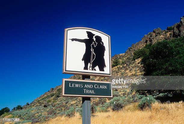 lewis and clark trail road sign - the oregon trail stock photos and pictures