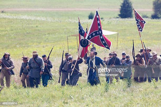 lewis armistead leads his confederate troops, flags held high - gunshot wound stock photos and pictures