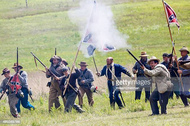 lewis armistead leads his confederate troops, hat on sword - reenactment stock photos and pictures