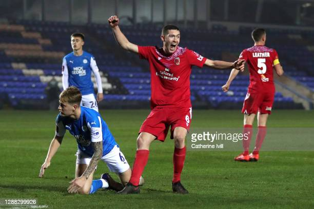 Lewis Baines of Chorley FC celebrates after scoring his team's second goal during the FA Cup Second Round match between Peterborough United and...