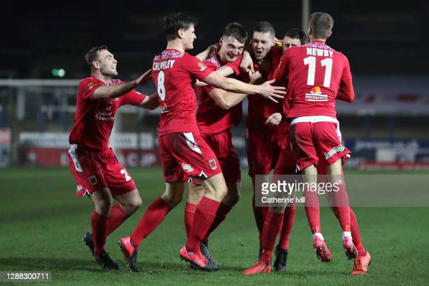 Lewis Baines of Chorley FC celebrates with teammates after scoring his team's second goal during the FA Cup Second Round match between Peterborough...