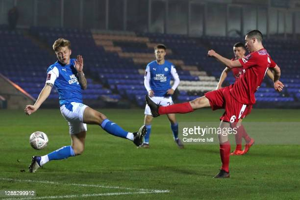 Lewis Baines of Chorley FC scores his team's second goal during the FA Cup Second Round match between Peterborough United and Chorley at the Weston...