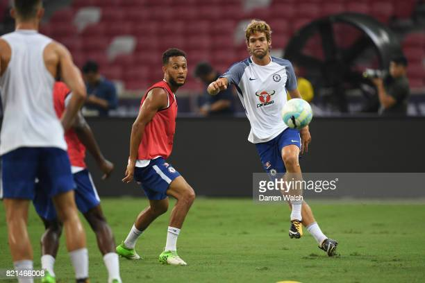 Lewis Baker and Marcos Alonso of Chelsea during a training session at Singapore National Stadium on July 24 2017 in Singapore