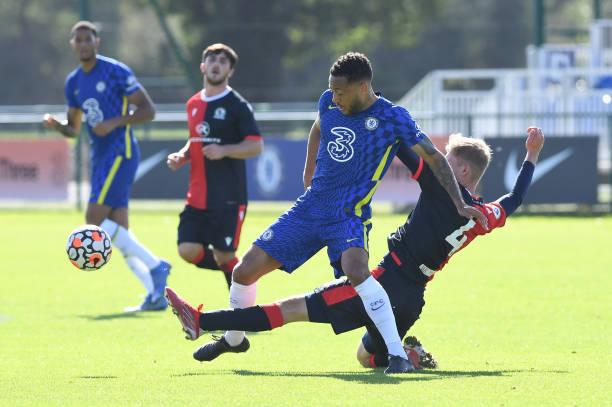 Lewis Baker of Chelsea is tackled by Jake Agrrett of Blackburn during the Chelsea v Blackburn Premier league 2 match on October 3rd, 2021 in Cobham,...