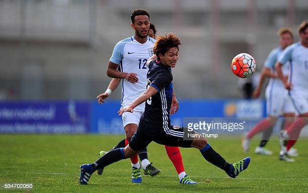 Lewis Baker of England looks to break past Takumi Minamino of Japan during the Toulon Tournament match between Japan and England at the Stade Leo...