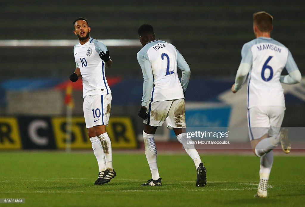 Lewis Baker of England U21 (10) celebrates with team mates Dominic Iorfa (2) and Alfie Mawson (6) as he scores their second goal during the U21 international friendly match between France and England at Stade Robert Bobin on November 14, 2016 in Paris, France.
