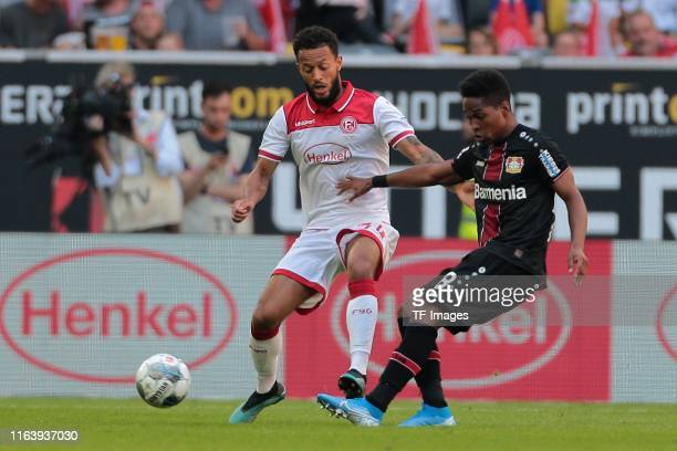 Lewis Baker of Fortuna Duesseldorf and Wendell of Bayer 04 Leverkusen battle for the ball during the Bundesliga match between Fortuna Duesseldorf and...