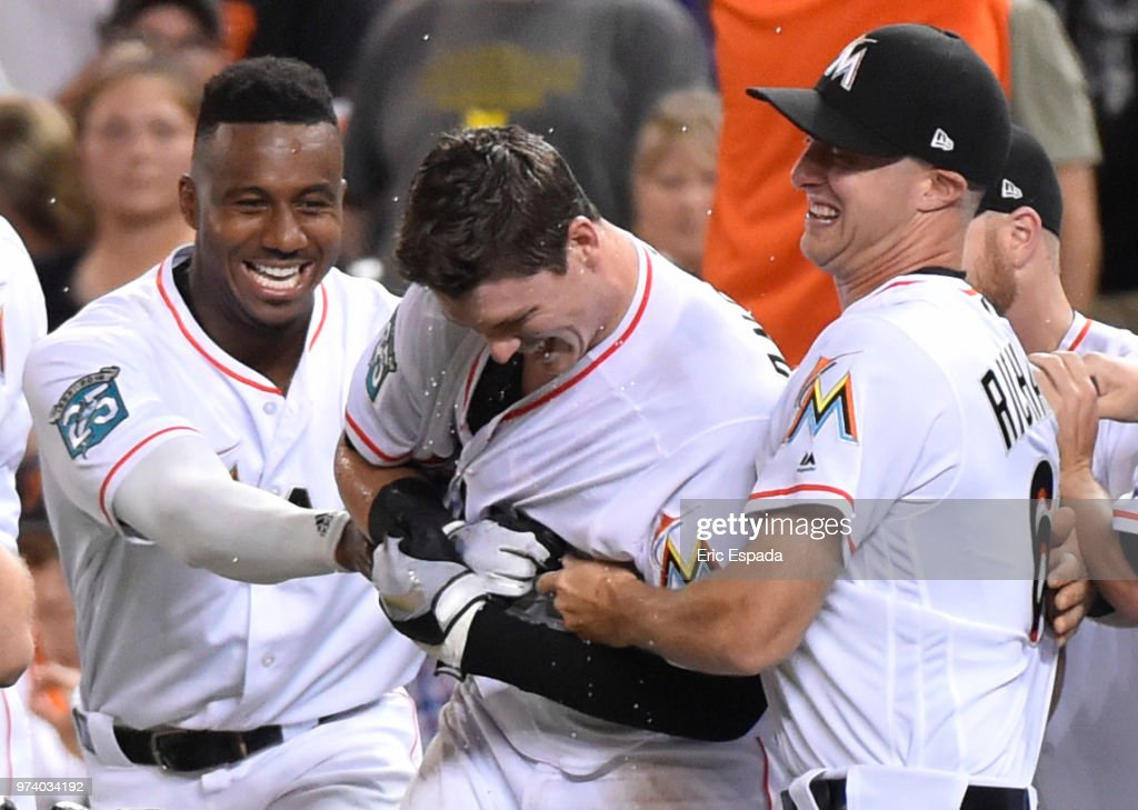 Lewis Brinson #9 and Trevor Richards #63 of the Miami Marlins celebrate with Brian Anderson #15 of the Miami Marlins after he hit the game winning sacrifice fly in the ninth inning against the San Francisco Giants at Marlins Park on June 13, 2018 in Miami, Florida.