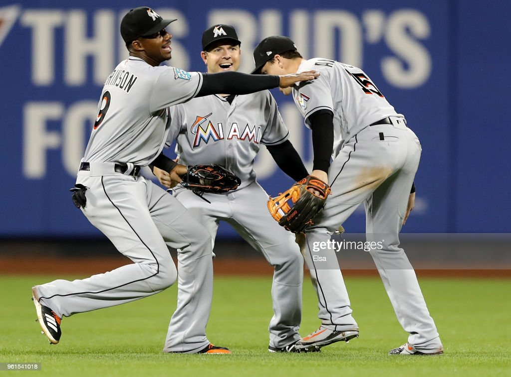 Lewis Brinson #9, J.B. Shuck #3 and Brian Anderson #15 of the Miami Marlins celebrate the 5-1 win over the New York Mets at Citi Field on May 22, 2018 in the Flushing neighborhood of the Queens borough of New York City.