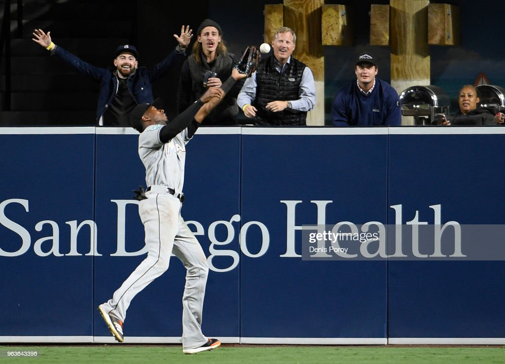 Lewis Brinson #9 of the Miami Marlins can't make the catch on a ball hit by Freddy Galvis #13 of the San Diego Padres during the ninth inning of a baseball game at PETCO Park on May 29, 2018 in San Diego, California.