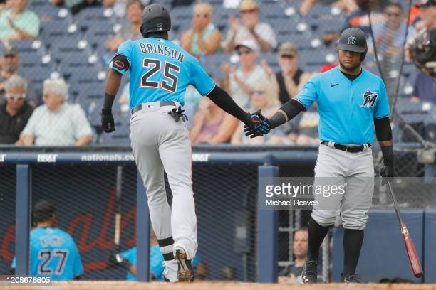 Lewis Brinson of the Miami Marlins celebrates with Harold Ramirez after hitting a solo home run against the Houston Astros in the second inning of a...