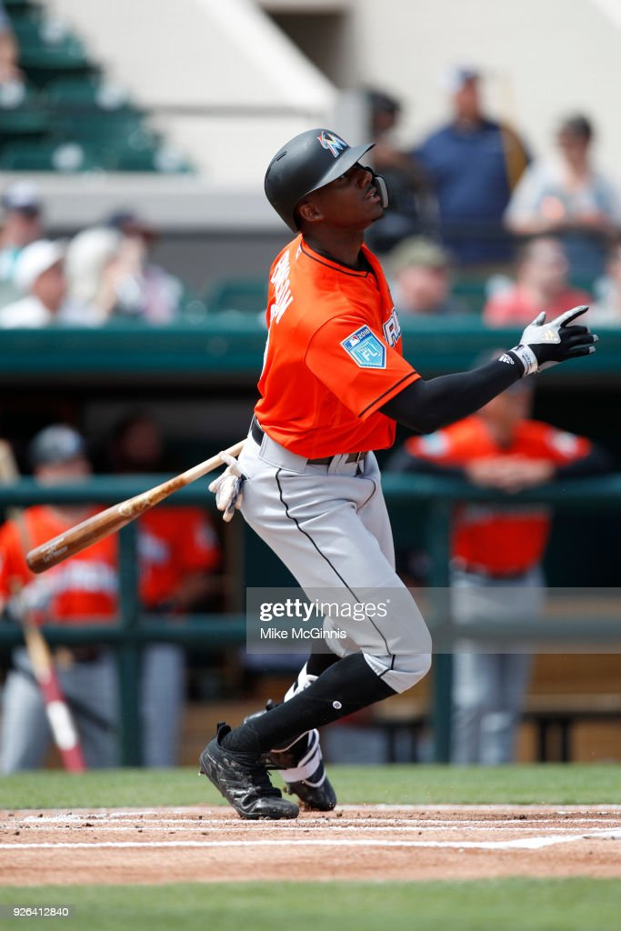Lewis Brinson #9 of the Miami Marlins hits a RBI triple during the first inning of the Spring Training game against the Detroit Tigers at Joker Marchant Stadium on March 02, 2018 in Lakeland, Florida.