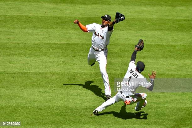 Lewis Brinson of the Miami Marlins makes the catch over Cameron Maybin in the fifth inning against the Chicago Cubs at Marlins Park on April 1 2018...