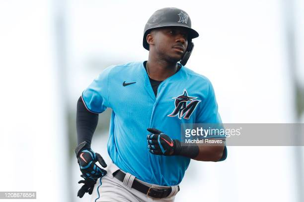 Lewis Brinson of the Miami Marlins rounds the bases after hitting a solo home run against the Houston Astros in the second inning of a Grapefruit...