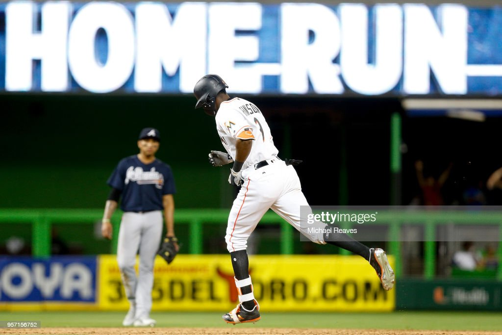 Lewis Brinson #9 of the Miami Marlins rounds the bases after hitting a home run in the ninth inning against the Atlanta Braves at Marlins Park on May 10, 2018 in Miami, Florida.