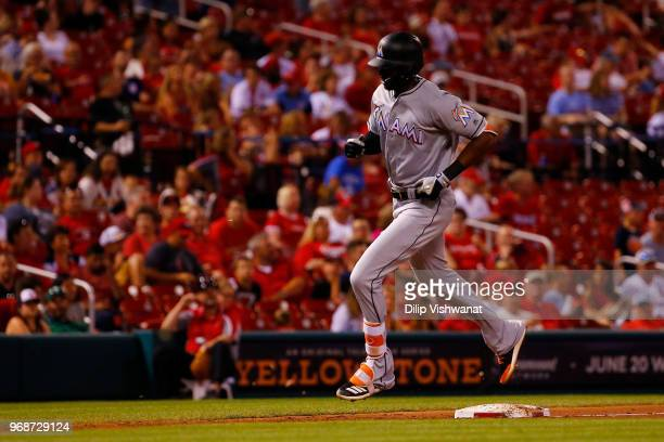Lewis Brinson of the Miami Marlins rounds third base after hitting a triple St Louis Cardinals in the seventh inning at Busch Stadium on June 6 2018...