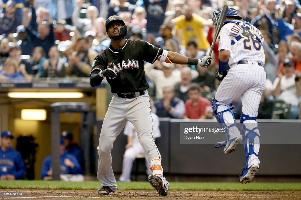 Lewis Brinson #9 of the Miami Marlins strikes out in the sixth inning against the Milwaukee Brewers at Miller Park on April 22, 2018 in Milwaukee, Wisconsin.