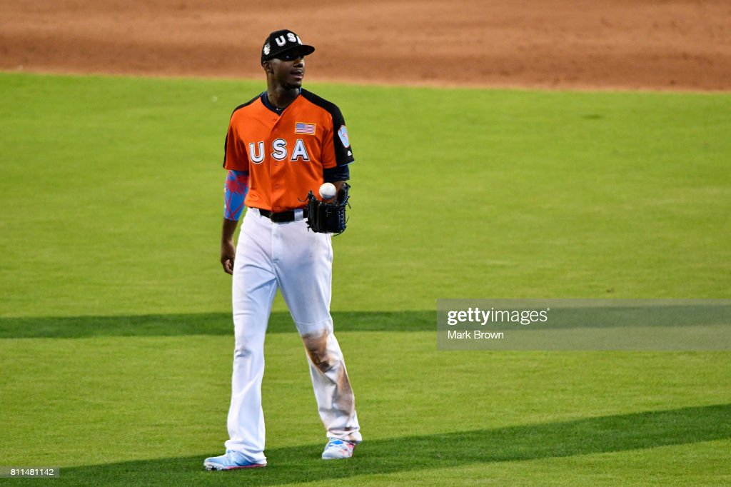 Lewis Brinson #20 of the Milwaukee Brewers and the U.S. Team looks on prior to the SiriusXM All-Star Futures Game at Marlins Park on July 9, 2017 in Miami, Florida.
