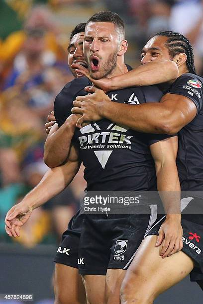 Lewis Brown of New Zealand celebrates a try with team mates during the Four Nations Rugby League match between the Australian Kangaroos and New...