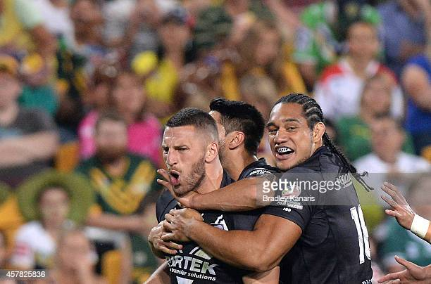 Lewis Brown of New Zealand celebrates scoring a try with team mates during the Four Nations Rugby League match between the Australian Kangaroos and...