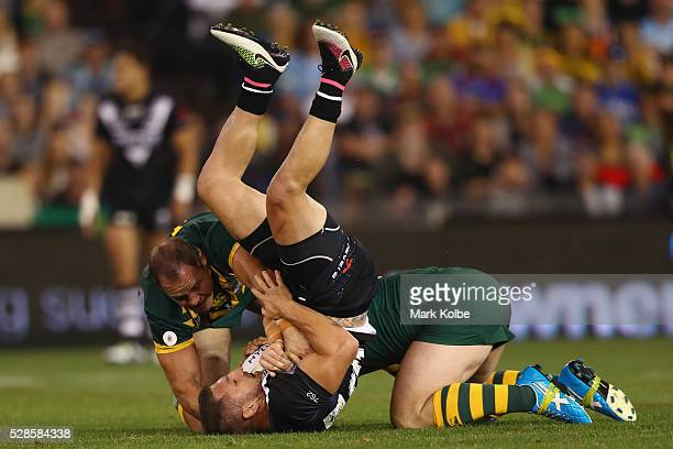 Lewis Brown of the Kiwis is tackled during the International Rugby League Trans Tasman Test match between the Australian Kangaroos and the New...